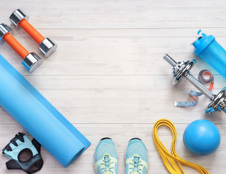 Sports equipment on a white wooden background. Top view. Motivation Reklamní fotografie - 114763753