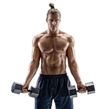 Handsome bodybuilder doing the exercises with dumbbells. Photo of strong man with naked torso isolated on white background. Strength and motivation.