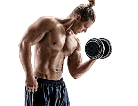 Muscular young guy doing exercises with dumbbell at biceps. Photo of sporty man with naked torso on white background. Strength and motivation Reklamní fotografie