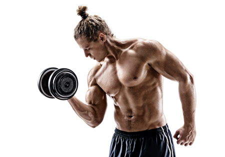 Athletic man doing exercises with dumbbell at biceps. Photo of sporty man with naked torso on white background. Strength and motivation