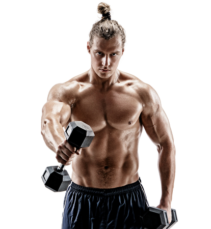 Sporty man working out with dumbbells. Photo of strong man with naked torso isolated on white background. Strength and motivation. Reklamní fotografie
