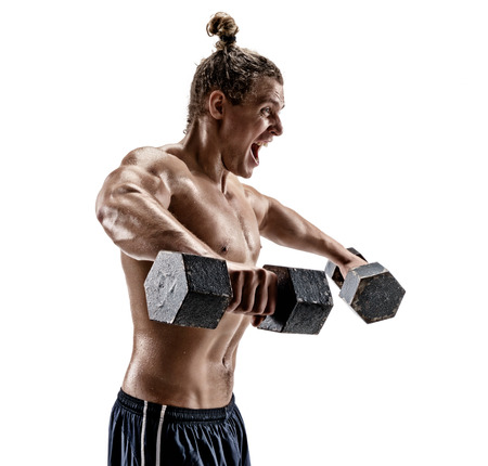 Muscular bodybuilder exercising. Photo of man working out with heavy dumbbells on white background. Side view