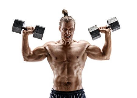 Muscular guy working out with dumbbells. Photo of guy with naked torso isolated on white background. Strength and motivation.