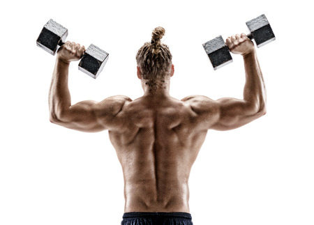 Strong back of muscular man working with dumbbells. Photo of sporty man shirtless isolated on white background. Strength and motivation.