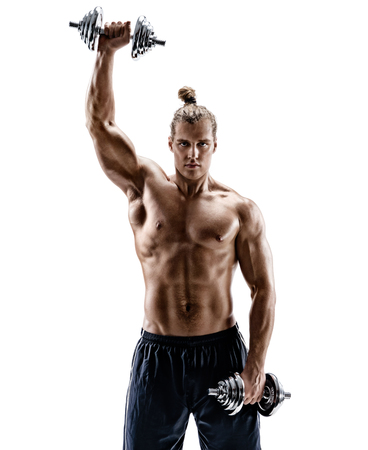 Athletic man pumping up muscles with dumbbells. Photo of sporty muscular male with naked torso isolated on white background. Strength and motivation.