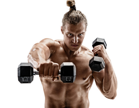 Powerful man doing boxing exercises, making direct hit with dumbbells. Photo of sporty muscular male on white background. Strength and motivation