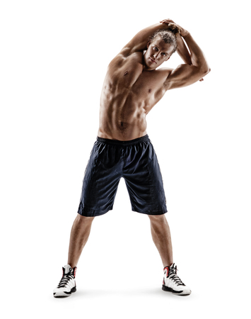 Athletic man doing exercises for stretching the lateral muscles of the trunk. Photo of muscular man isolated on white background. Strength and motivation. Full length