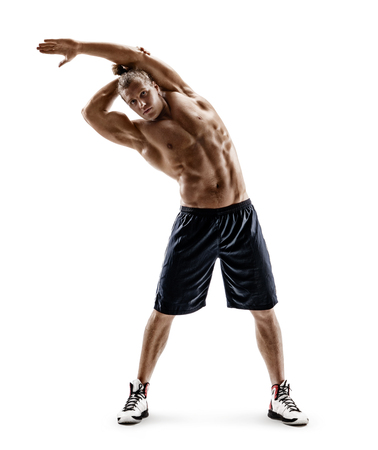 Sporty man doing exercises for stretching the lateral muscles of the trunk. Photo of young man isolated on white background. Strength and motivation. Full length Stock Photo