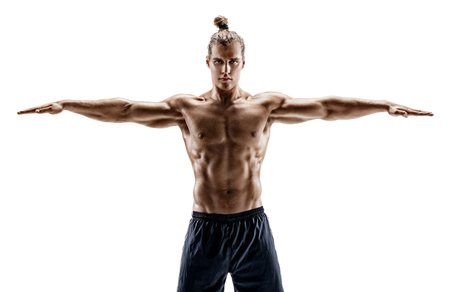 Handsome young man with perfect body performs fitness exercises on white background. Strength and motivation
