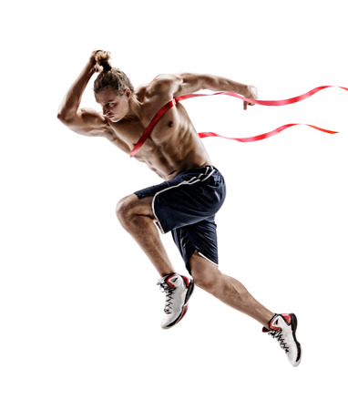 Man running, crossing finish line. Photo of young man isolated on white background. Sport and healthy lifestyle. Dynamic movement. Competition event. Full length Archivio Fotografico