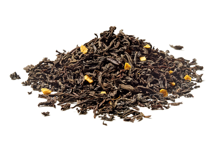 Heap of black tea with passion fruit pieces on white background. Close up. High resolution. Stock fotó
