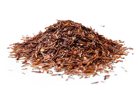 Heap of Rooibos tea on white background. Close up. High resolution