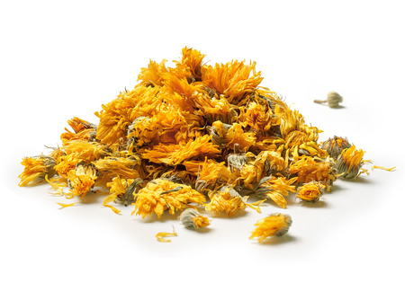 Heap of medicinal flowers of a calendula on white background. Herbal tea. Close up. High resolution Stockfoto