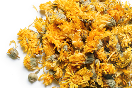 Medicinal flowers of a calendula on white background. Herbal tea. Top view. Close up. High resolution