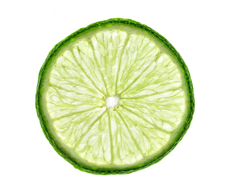 Slice of lime isolated on white background. Close up. Top view. High resolution product