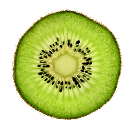Slice of kiwi fruit isolated on white background. Close up. Top view. High resolution product
