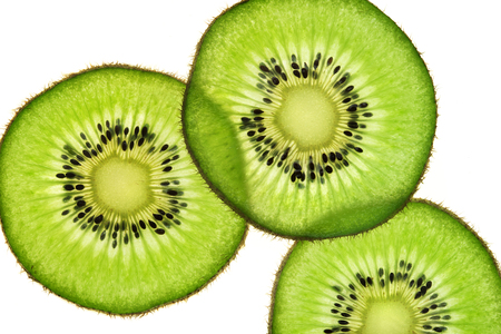 Slices of kiwi fruit on white background. Top view. Close up. High resolution product 写真素材