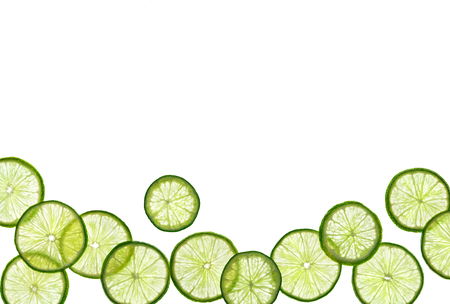 Slices of lime on white background. Copy space for your text. Top view. High resolution product