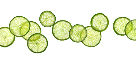 Slices of lime isolated on white background. Close up. Top view. High resolution product Stock Photo