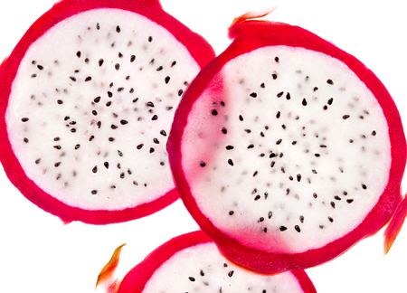 Slices of dragon fruit on white background. Close up. Top view. High resolution product 写真素材