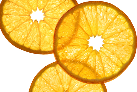 Slices of orange on white background. Close up. Top view. High resolution product