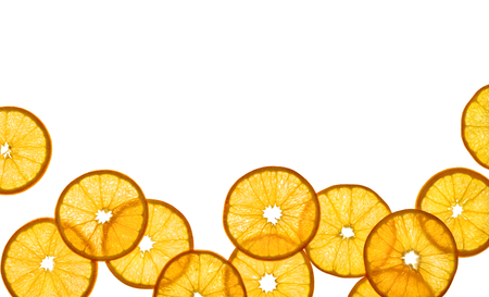 Slices of orange on white background. Copy space for your text. Top view. High resolution product