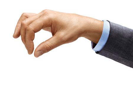 Mans hand in suit holds something isolated on white background. Close up. High resolution product.