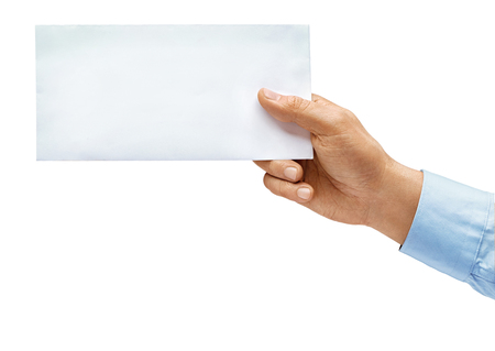 Mans hand in shirt holds envelope isolated on white background. Close up. High resolution product