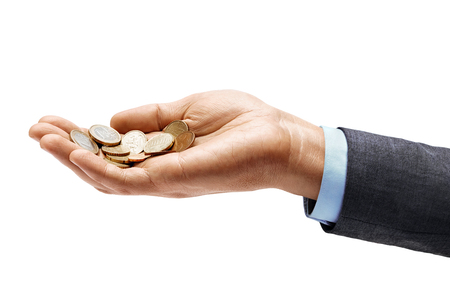 Mans hand in suit holding a heap of different coins isolated on white background. Close up. High resolution product. Business concept