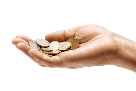 Mans hand holding a heap of different coins isolated on white background. Close up. High resolution product. Business concept