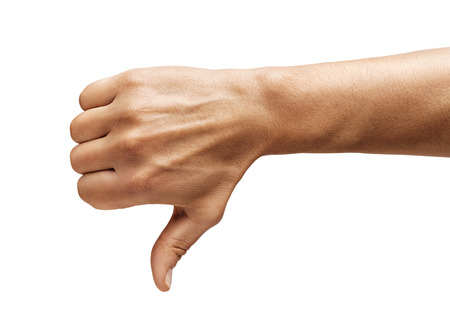 Mans hand shows thumb down isolated on white background. Negative concept. Close up. High resolution product.