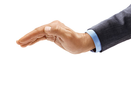 Man's hand in suit makes a gesture of protection isolated on white background. Inverted open palm, close up. High resolution product 免版税图像