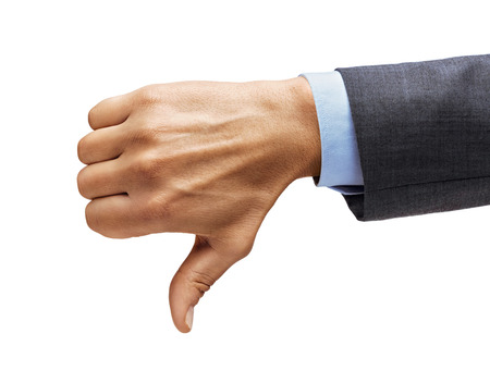 Mans hand in a suit shows thumb down isolated on white background. Negative concept. Close up. High resolution.