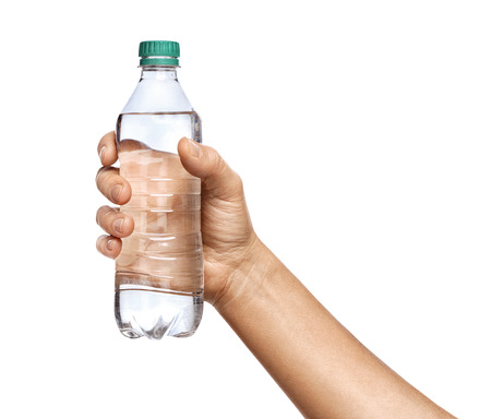Man's hand in shirt holds bottle of water, isolated on white background. Close up. High resolution product 写真素材 - 123395984
