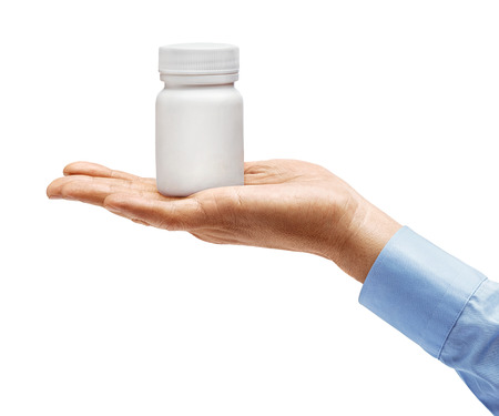 Man's hand in shirt holds medical bottle with pills isolated on white background. Palm up, close up. High resolution product 写真素材 - 123395991