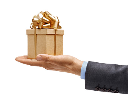 Mans hand in a suit holds gift box isolated on white background. High resolution product