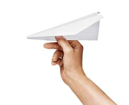 Mans hand holds paper plane isolated on white background. Close up. High resolution product 写真素材