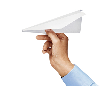 Mans hand in a shirt holds paper plane isolated on white background. Close up. High resolution product