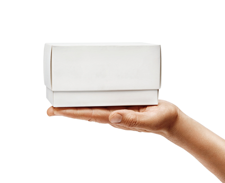 Mans hand holds white box isolated on white background. Close up. High resolution product