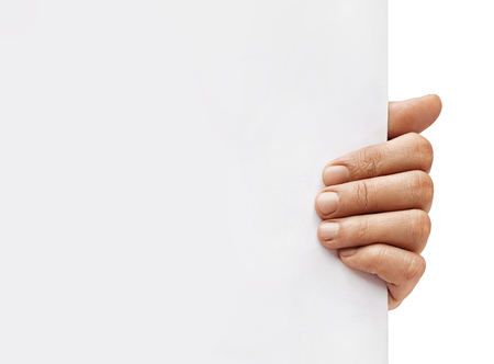 Copy space for your text. Close up of mans hand holding empty board on white background. High resolution 스톡 콘텐츠