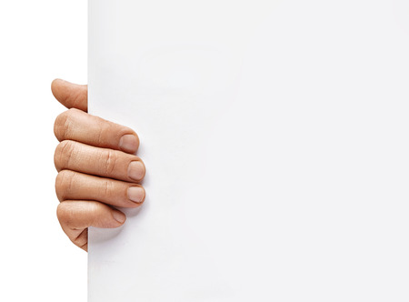 Copy space for your text. Mans hand holding empty board on white background. Close up. High resolution product 写真素材