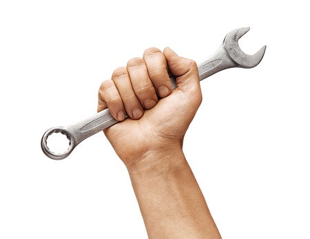 Mans hand holds a wrench isolated on white background. Close up. High resolution product 写真素材
