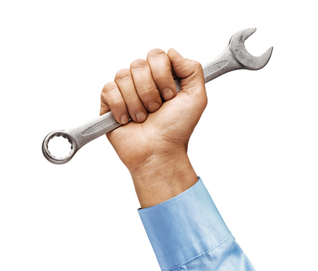 Mans hand in a shirt holds a wrench isolated on white background. Close up. High resolution product