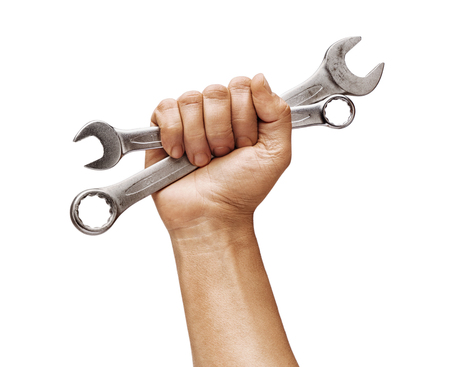 Mans hand holds a spanners isolated on white background. Close up. High resolution product