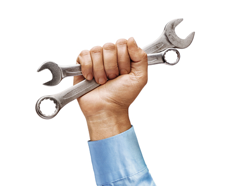 Mans hand in a shirt holds a spanners isolated on white background. Close up. High resolution product