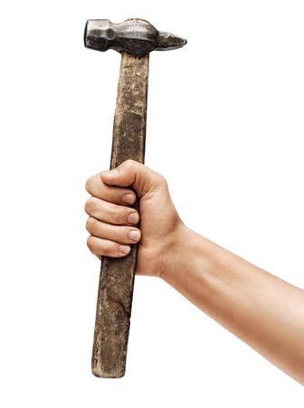 Mans hand holds a hammer isolated on white background. Close up. High resolution product
