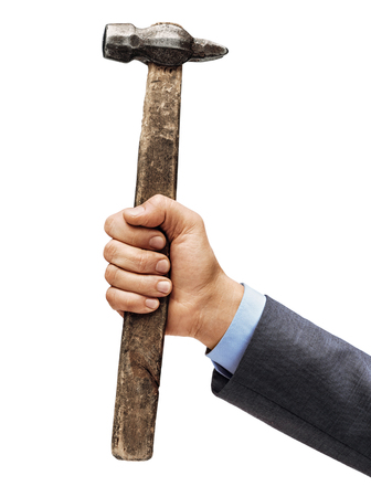 Mans hand in a suit holds a hammer isolated on white background. Close up. High resolution product 写真素材