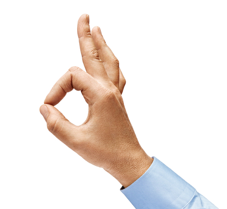 Mans hand in a shirt shows gesture okay. Positive concept. Close up. High resolution product