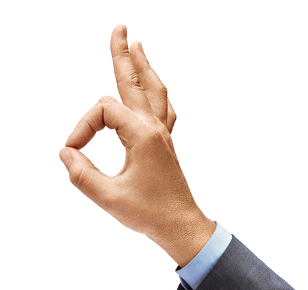 Mans hand in a suit shows gesture okay. Positive concept. Close up. High resolution product Stock Photo