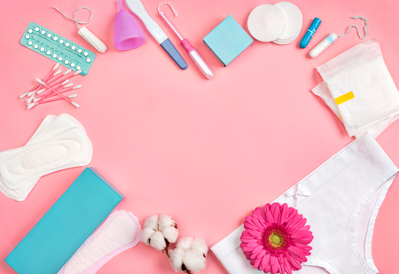 Heart symbol. Sanitary napkins and other hygiene accessories on pink background. Concept of critical days, menstruation 写真素材 - 123827738